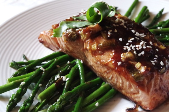 salmon on a bed of asparagus